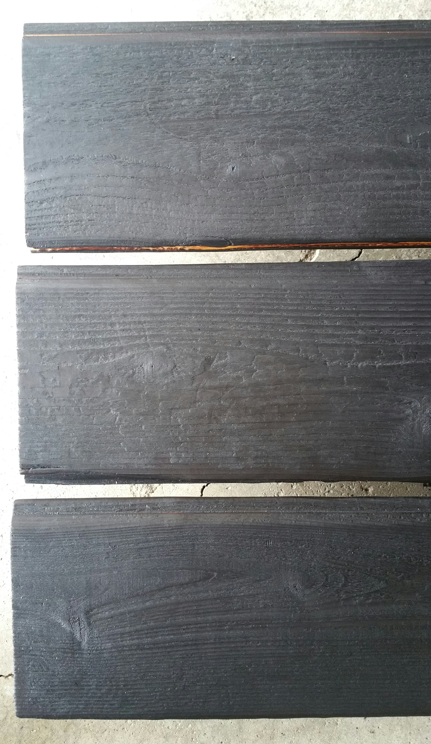 oiled-charred-boards-on-the-stack-to-dry