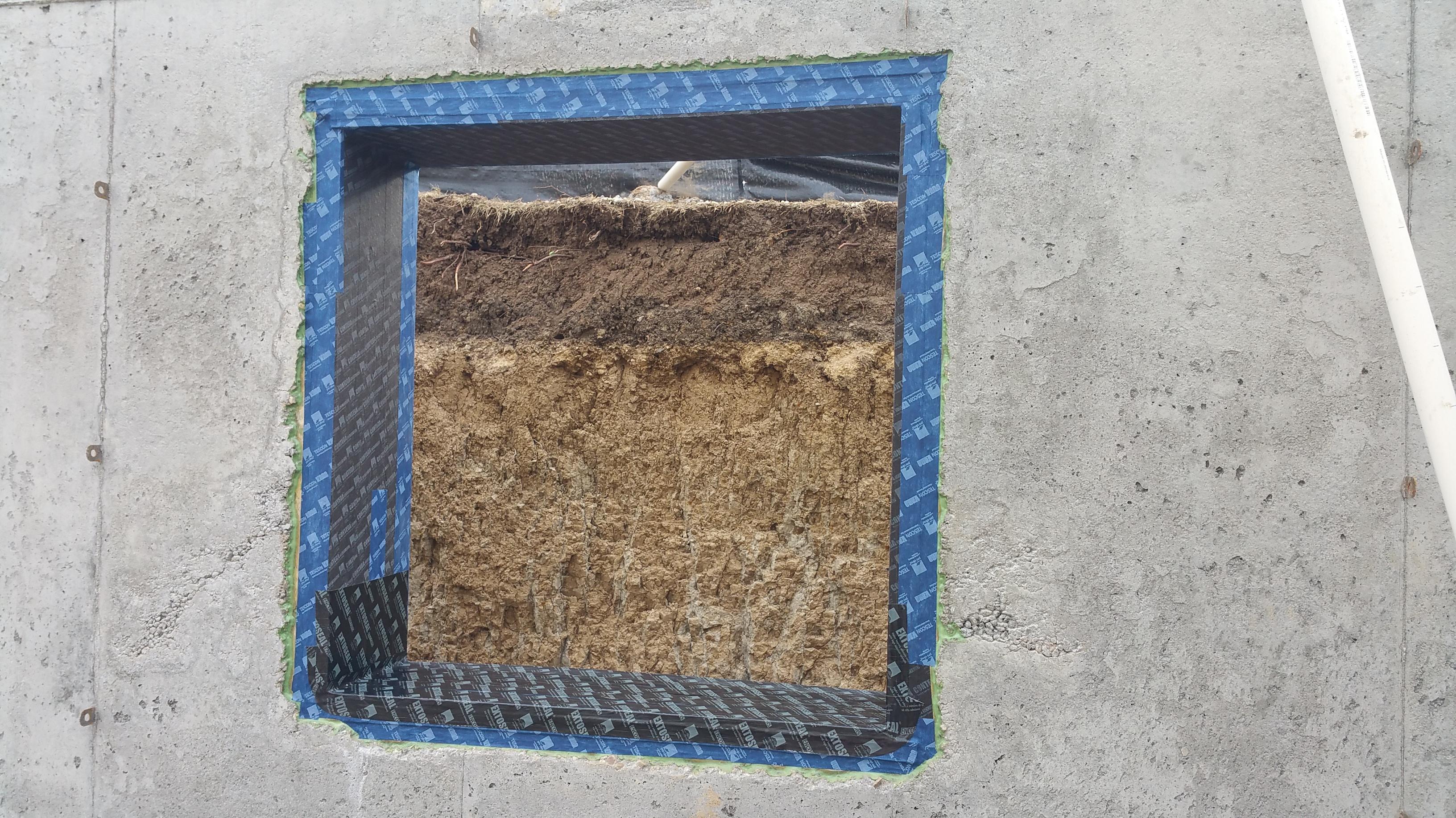 basement-window-buck-covered-in-tape
