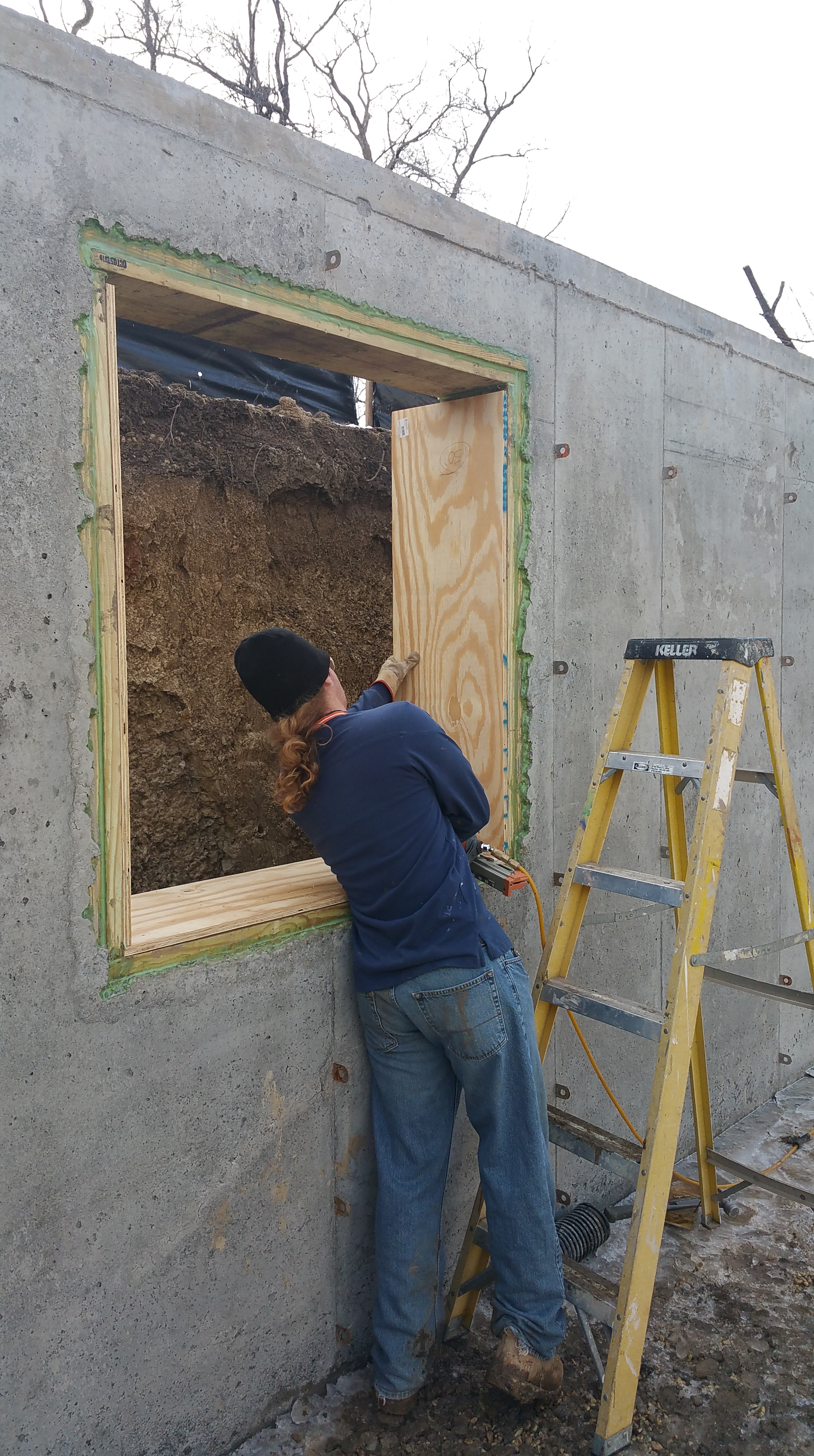 nils-installing-basement-window-bucks
