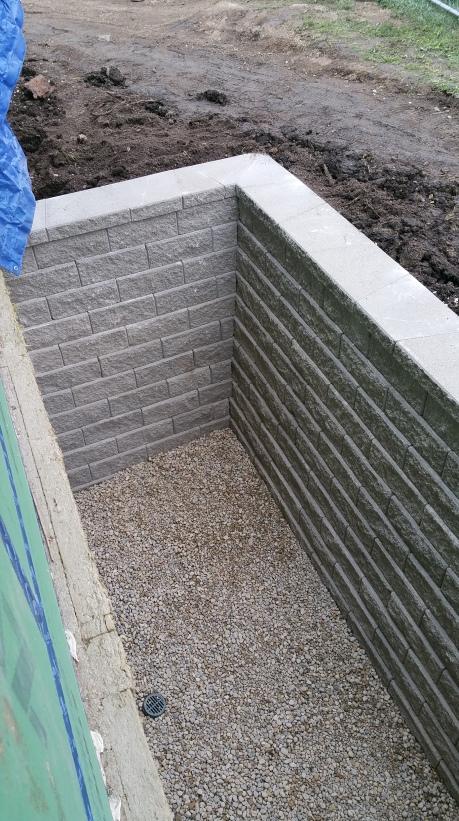 corner of finished window well (east)