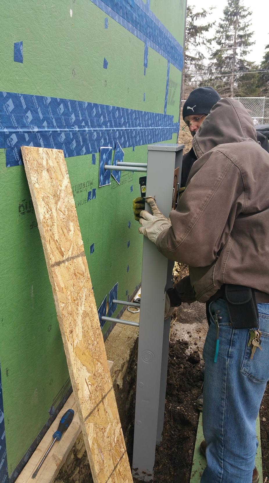 John & Donny installing meter