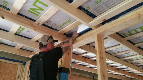 Anthony putting self-adhering gasket over solar conduit penetration