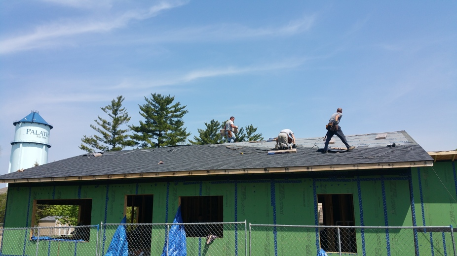 roofers shingling south side