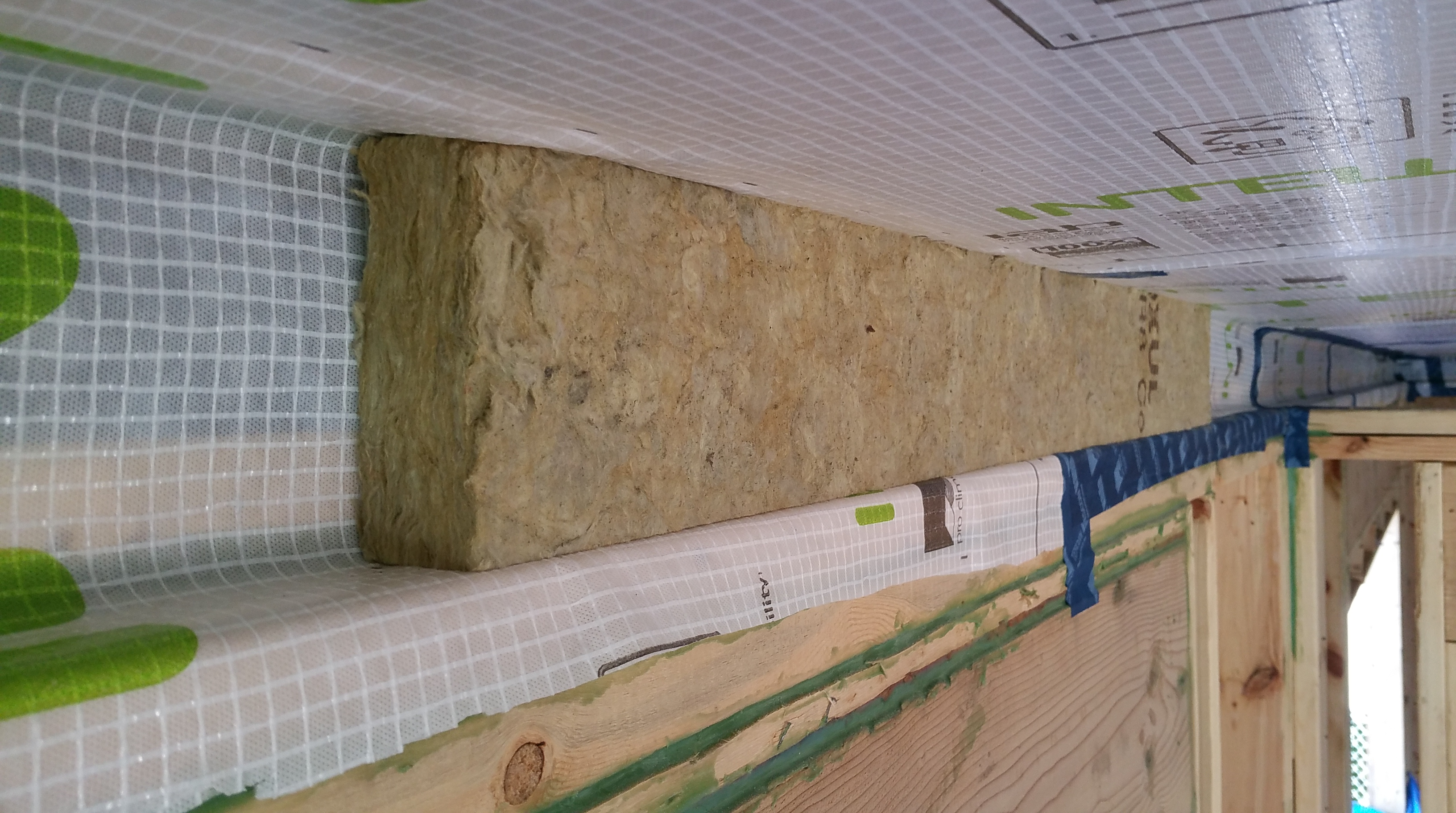 layer of Roxul at top of outside wall