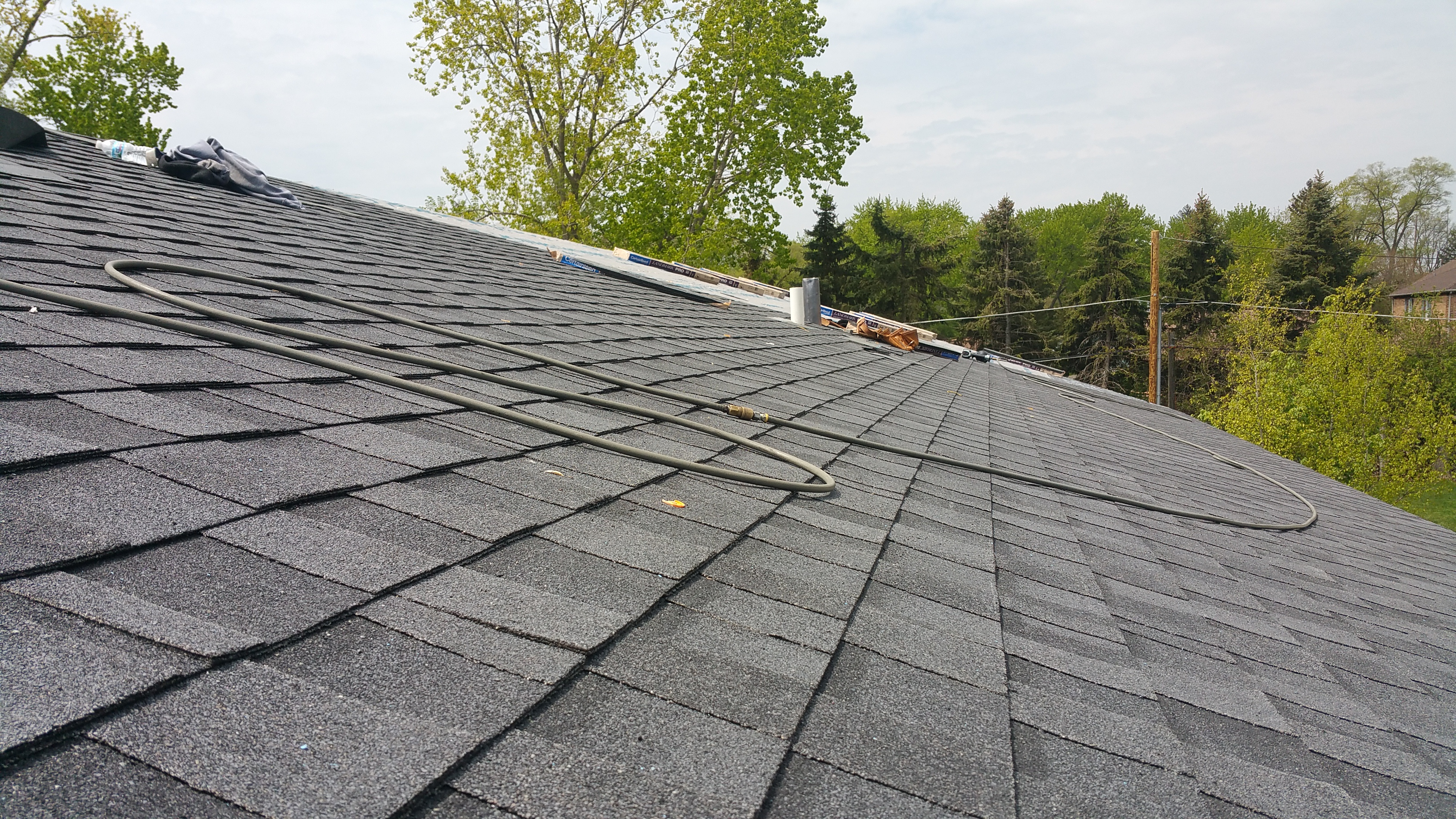 shingles being installed w: vents