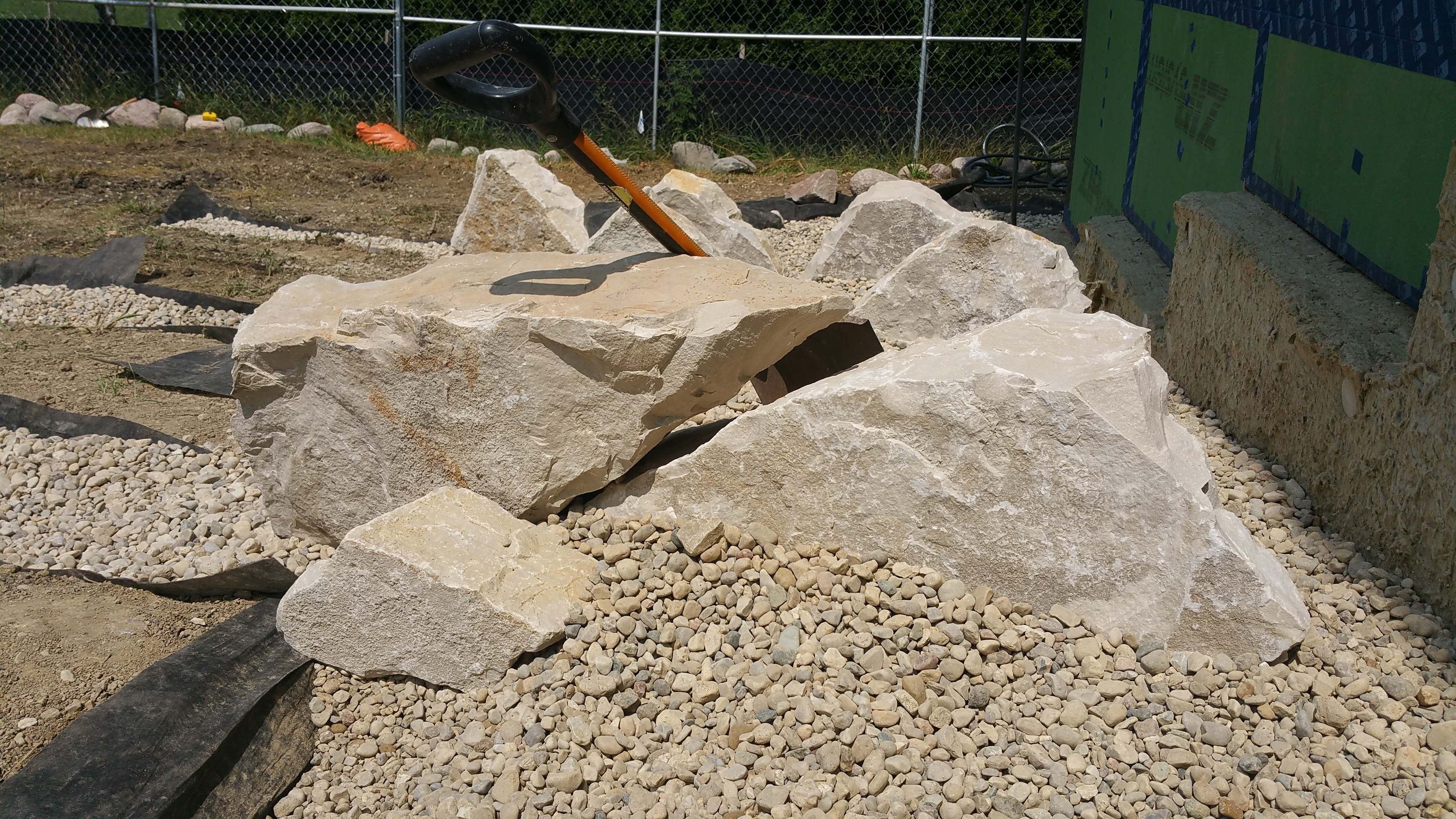 first boulders going in on west side