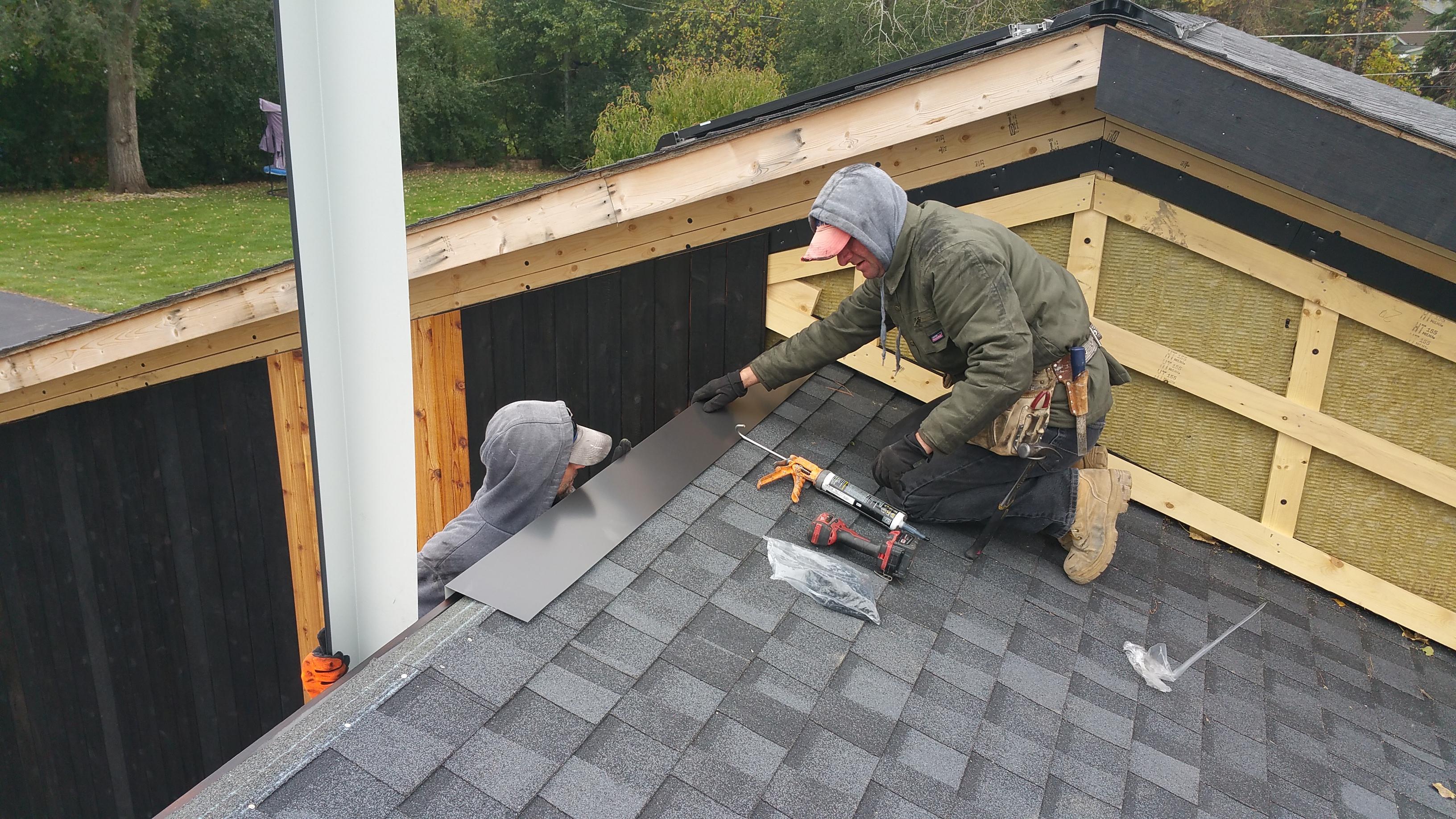 mark and wojtek install 1st pce garage roof flashing