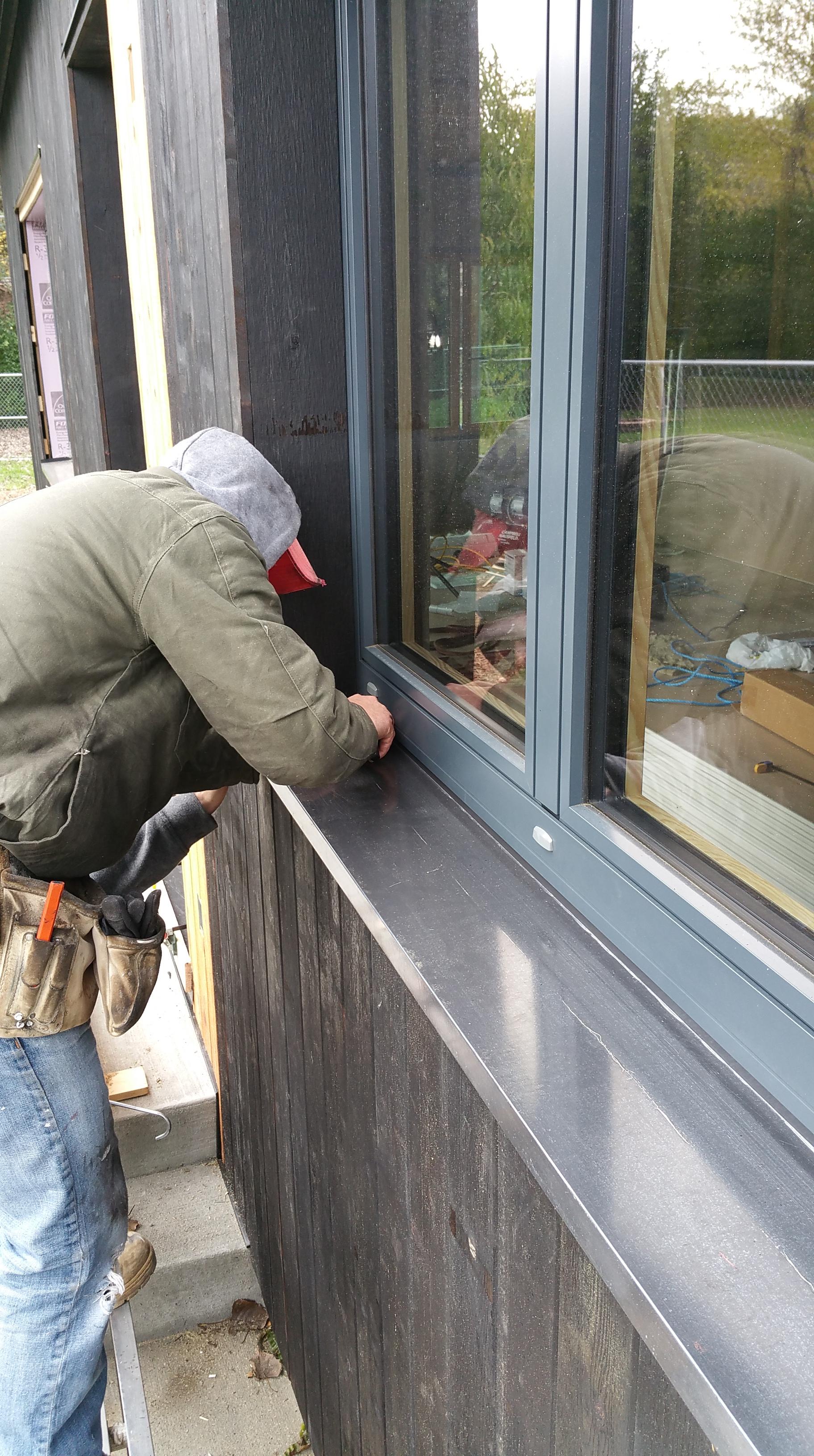 Wojtek installing first sill pan