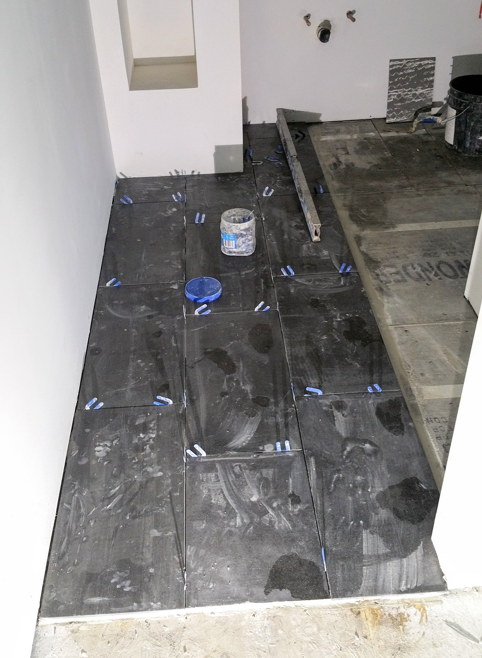 mbath floor tile going down